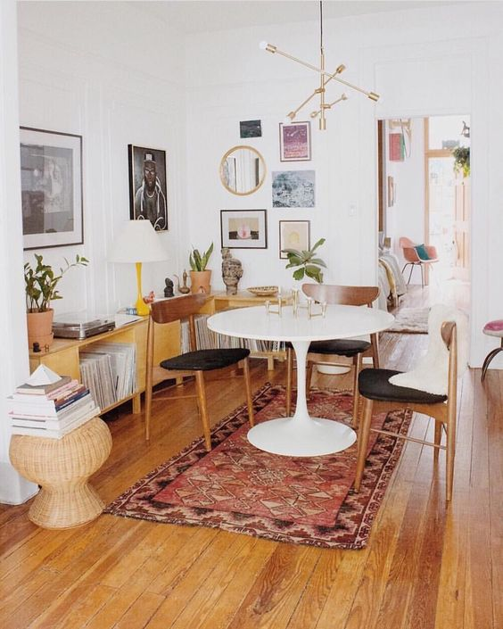 Dining room with Saarinen table. Boho chic Brooklyn apartment.