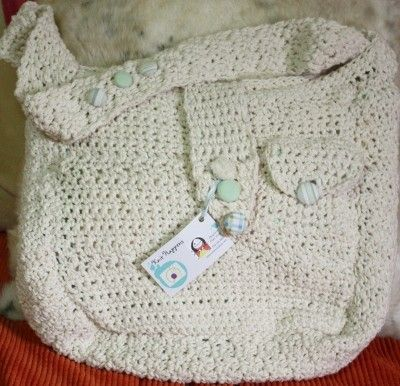"""This creamy, heavy, over sized saddlebag was made to fit all your purse needs.  It measures 17"""" X 14"""" and has two outer pockets with handmade buttons that match inner lining.  The inner lining was made with patchwork flannel and antique yellow chenille.  This can also be a sweet diaper bag for the fashionable mother.  The strap is heavy and measures 36"""".  The purse is comfortable and lays softly against the body."""