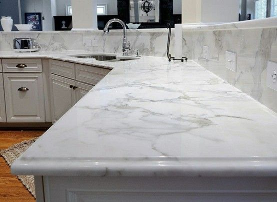 Calcutta Gold Marble On Perimeter With A 6cm Small Ogee Bullnose