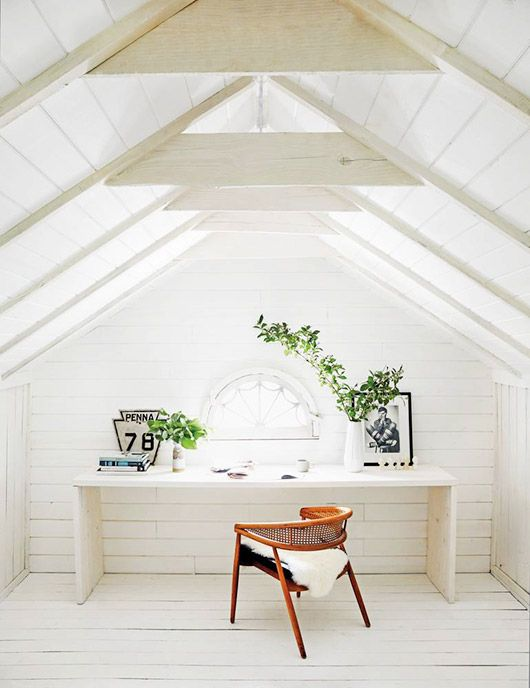 A white attic office with minimal wood desk, fan window, and vintage can chair draped with sheepkin from Restored by the Fords HGTV show. / photos by nicole franzen for domino