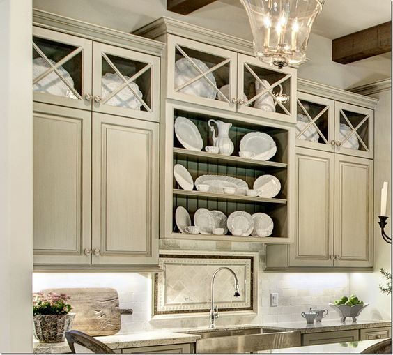 The cabinets were painted a custom color then glazed by Segreto to give them a furniture quality finished look.  And I can attest -  Leslie's cabinet treatments really do look like expensive furniture!  Gorgeous!