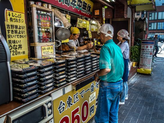 "The bento lunch-boxes of ""Delika Pakupaku"", the small store next to the A1 exit of the Tsukuba Express line Asakusa station, stacked for the lunch rush hour. #Asakusa, #Rokku, #Tsukuba, #Express, #bento, #Delika, #Pokupoku 2/2 August 21, 2014 © Grigoris A. Miliaresis"