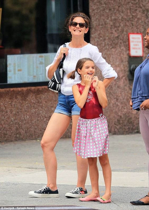 Two of a kind: 10-year-old Suri Cruise seemed in great spirits as she enjoyed a day out with her lookalike mum Katie Holmes on Wednesday as they grabbed a drink in New York