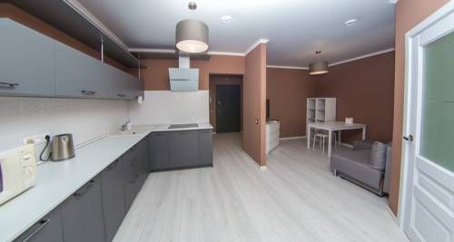 Apartment Krasnaya 176 Krasnodar Located 2.4 km from Krasnodar Expo, Apartment Krasnaya 176 offers accommodation in Krasnodar. The apartment is 100 metres from City Centre Shopping Mall. Free WiFi is provided .  The kitchen has a microwave.