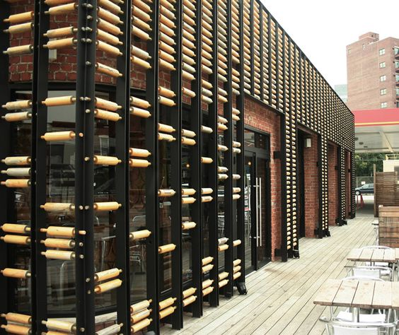 Interesting use of wooden rolling pins on the facade of for Retail exterior design