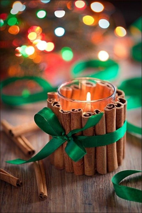 Cute DIY Candle Holder for Christmas…Glue cinnamon sticks around a glass votive jar and tie with a ribbon. Quick homemade gift!: