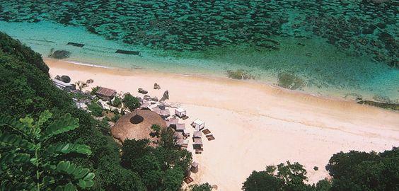 Karma Kandara - Karma Beach Club. Grab one of the big double sunbeds with an umbrella.