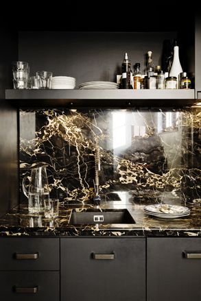 Luxurious kitchen in rare nero portoro marble by Groves Natcheva Architects, London
