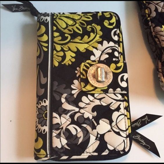 Vera Bradley Wallet Larger size wallet with lots of space and can hold everything.  Normal wear, no damage. Vera Bradley Bags Wallets