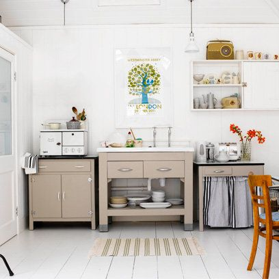 Freestanding kitchen cabinets for small kitchens will stop the room feeling too rigid, like this small kitchen with a neutral palette.
