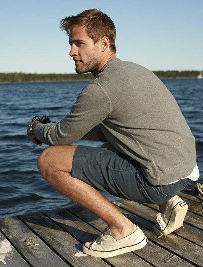 Gray sweater, slate shorts and cream / white canvas boat shoes