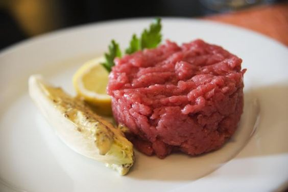 Carne Cruda is a raw beef dish Italian answer to steak tartare. Instead of an egg, this dish is served with lemon juice and olive oil.