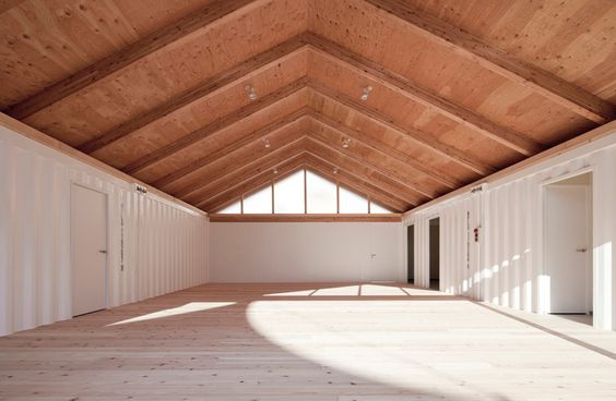 Eco Architecture -  Onagawa temporary container housing and community center. [Architects: Shigeru Ban. Image © Hiroyuki Hirai]