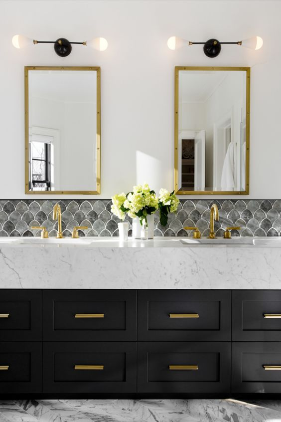 Add a beautiful seashell mosaic to your bathroom backsplash. It's a great way to add some whimsy to your bathroom without giving up a timeless, sophisticated style. Ask for a sample today! #tile #glassmosaics #glass