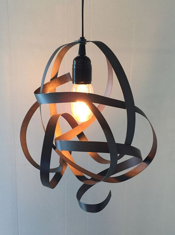 """We've shaped salvaged steel construction bands into this quirky abstract """"scribble"""" lamp. The lightweight steel material is very malleable and can be reshaped with a little light bending or """"fluffed"""""""