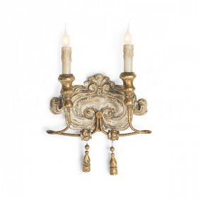 An ornately carved wall plate and distressed gold gilding bring the Aidan Gray Greta Gold wall sconce an aged patina