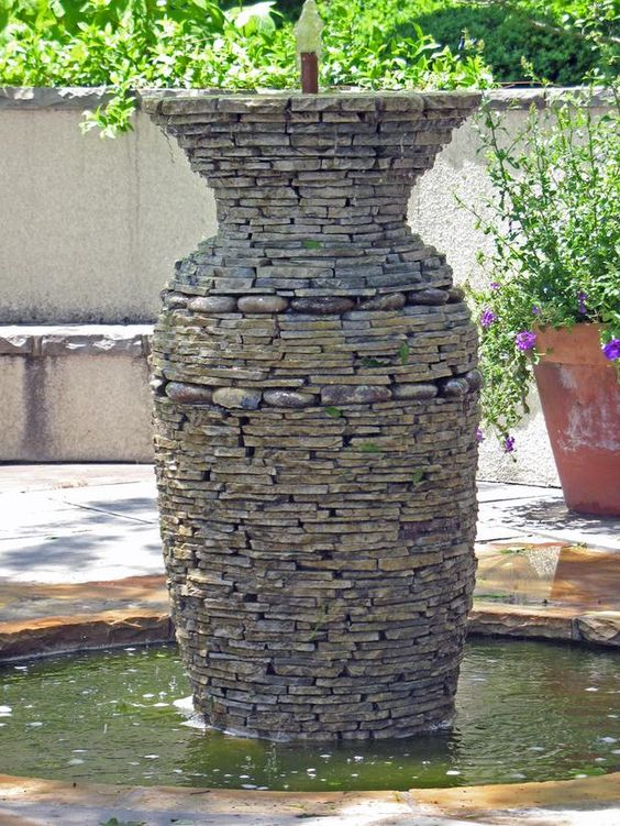 This stacked-stone vase is a courtyard fountain. From 15 Unique Water Gardens