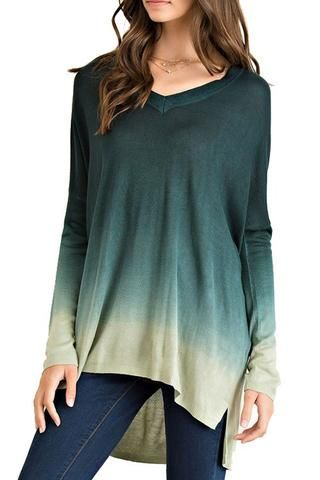 Ombre knit tunic starts with a dark hunter green top and fades to a light green on the bottom for the perfect ombre look! This light weight knit sweater is perfect for summer nights or wearing in fall