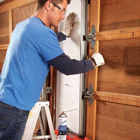 Noisy garage doors are often caused by worn rollers, loose hardware and tracks, and parts that need lubrication. With basic maintenance and troubleshooting you can usually fix the problem in an hour.