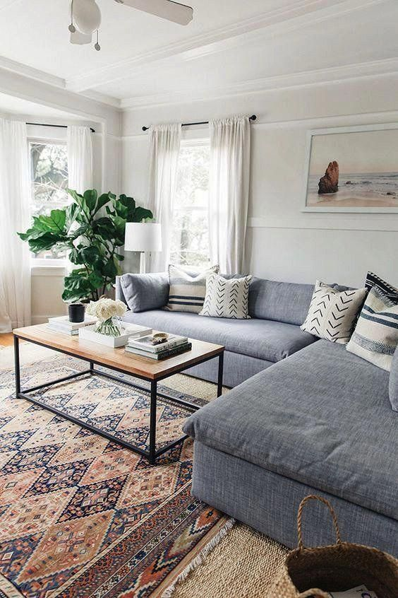 Large Sectional Couch In Living Room With Open Space And Rug