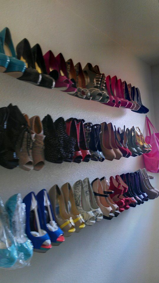 DIY shoe racks!!!  I bought $3 curtain rods from home depo and re-enforced the middle to hang my heels on!! Super cheap and simple!!