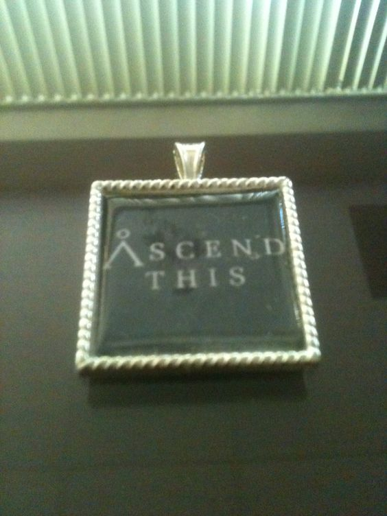 """Stargate Sg1 Inspired """"Ascend This"""" Silver Tone Metal Pendant"""