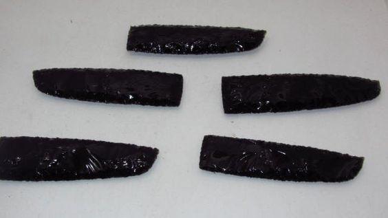 5 Obsidian knife blades.......05C71..... Ornamental replica primitive tool.....