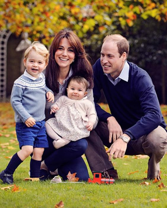 This undated handout image provided by Kensington Palace on December 18, 2015 shows Prince William, Duke of Cambridge and Catherine, Duchess of Cambridge with their children, Prince George and Princess Charlotte, in a photograph taken late October at Kensington Palace.