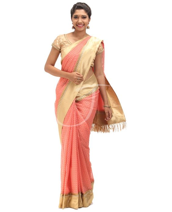 Net Jute Fabric. Rs 5320 Product Code : TS-546 Body is peach n golden color santing thread work lines with border. Attached golden border. Pallu is peach n golden color santing thread work lines with saree border. Blouse is golden tissue with small saree border.