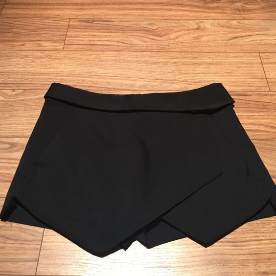 Zara Black Mini Skort *No trades* Used Zara Black Mink Skort. Not sold at Zara anymore, some balling in the back which you can see in the pictures. Zara Skirts