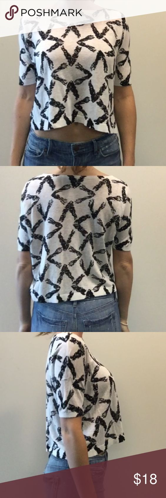"""Ann Taylor Loft Crop Top Sweater Black and white geometric crop top sweater. Ann Taylor Loft Size XS.  Machine washable. Model is 5'8"""" with 28"""" waist and 36"""" bust. LOFT Tops Crop Tops"""