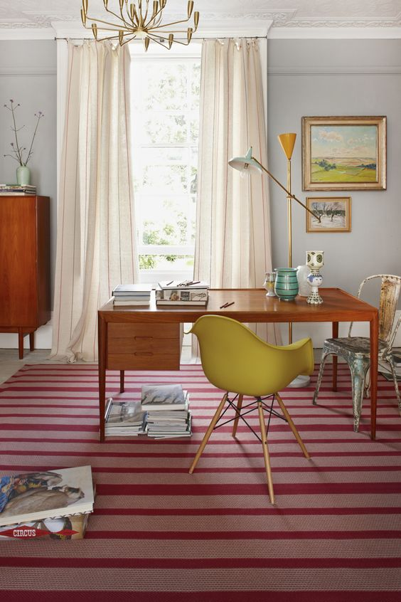 The classic 'Lyon Raspberry' design, seamed together to create a large rug for this contemporary office space
