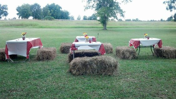 Tables with hay bales to sit on