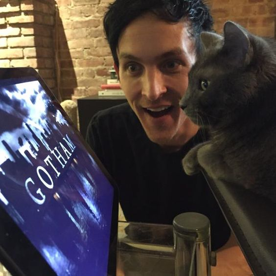 Robin Lord Taylor & Finn watching Gotham together! (This is how my cat, Charlie and I spend some evenings...though he has other tastes in shows. :p - Harriet)