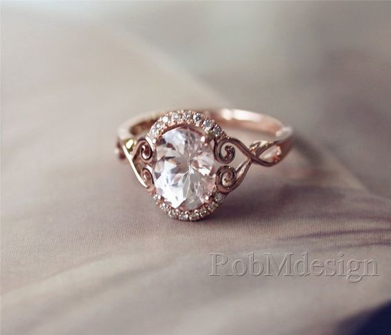 halo design and morganite ring on