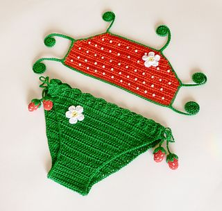 """Strawberry two-piece/bikini swim suit. Free crochet pattern that is listed as """"intermediate"""". Pattern is for infant through adult."""