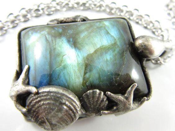 the land beneath waves  labradorite crystal by callistojewelry