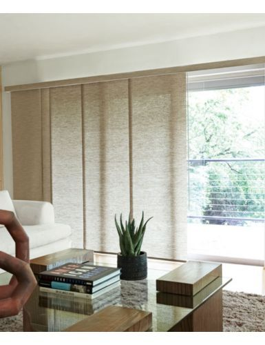 Modern panel track covers this wall to wall window home for Window treatments for door walls