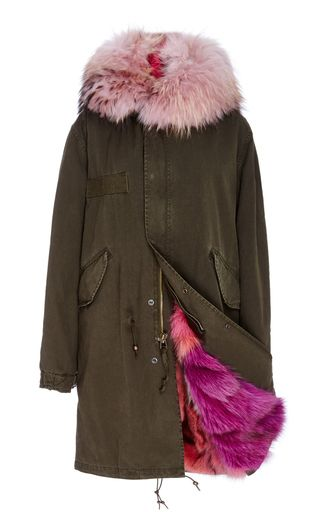 This dark green cotton canvas **Mr & Mrs Italy** parka features a utilitarian style with a pink racoon trimmed hood and a tonal fox fur lining.: