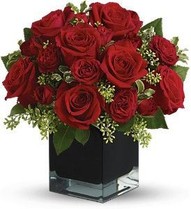Lush, lavish and spectacularly chic, this gorgeous contemporary bouquet of red roses in a stunning black cube vase makes an exciting gift for almost anyone. Wouldn't you love for someone to send it to you?    The brilliant bouquet includes red roses and red spray roses.    Delivered in a black contemporary glass cube vase.TFWEB596: