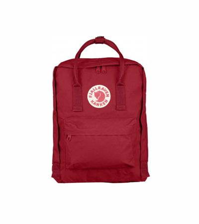 Fjall Raven Kånken - Deep Red  Classic Kånken backpack with zipper that opens the entire main compartment. Very hardwearing vinylon fabric. Removable seat cover at the back. Simple shoulder straps and handle on top. Reflector in the logo.