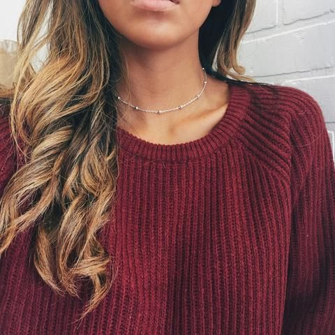 zilveren ketting combinatie rode trui