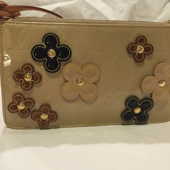 Louis Vuitton Montebello Vernis Tan Vernis with shades of brown flowers attached. Louis Vuitton Bags Mini Bags