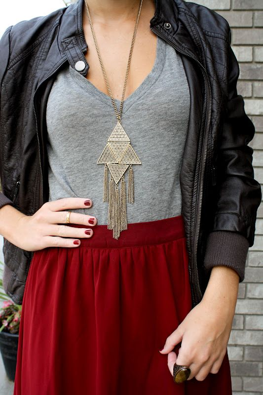 Leather jacket, simple tee, crimson skirt & big jewelry: