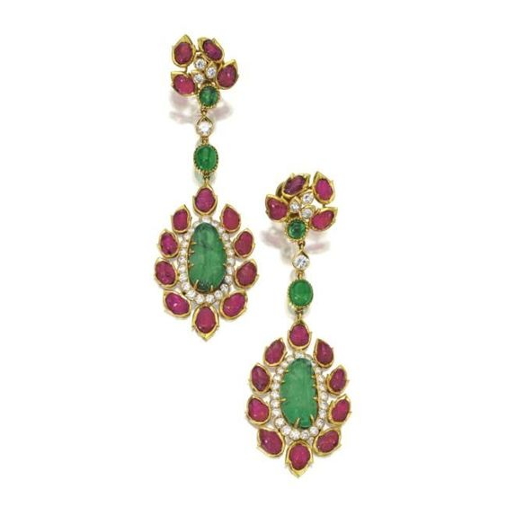 Pair of emerald, ruby and diamond 'mogul style' pendant-earclips, Cartier, Paris. photo Sotheby's    Round diamonds weighing approximately 3.75 carats, additionally set with carved emeralds and rubies, and cabochon emeralds, mounted in 18 karat gold