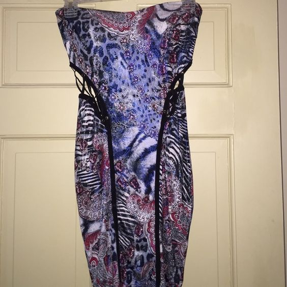 Amazing Strapless Dress  Unique Strapless Dress! Fits from small to medium due to stretch material. Great condition. Never worn! Built in bra. Dresses Mini