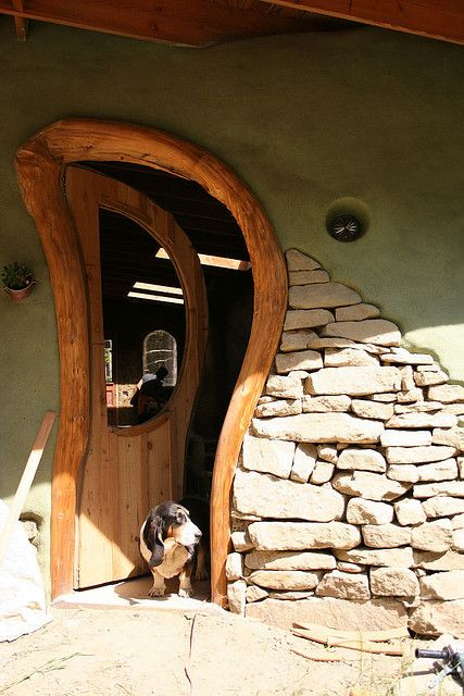 Love the curves on the door -- and  the dog! (Cob Building by Neil)