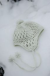 Ravelry: Snowbelle Trapper Hat pattern by Kalurah