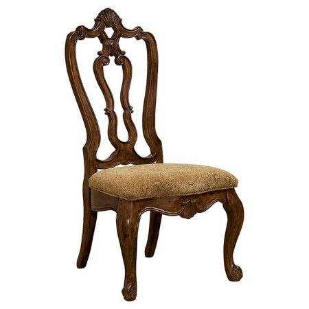 With graceful carved backs and crisp upholstery, these wood side chairs offer elegant appeal for your dining room or library.    Pr...