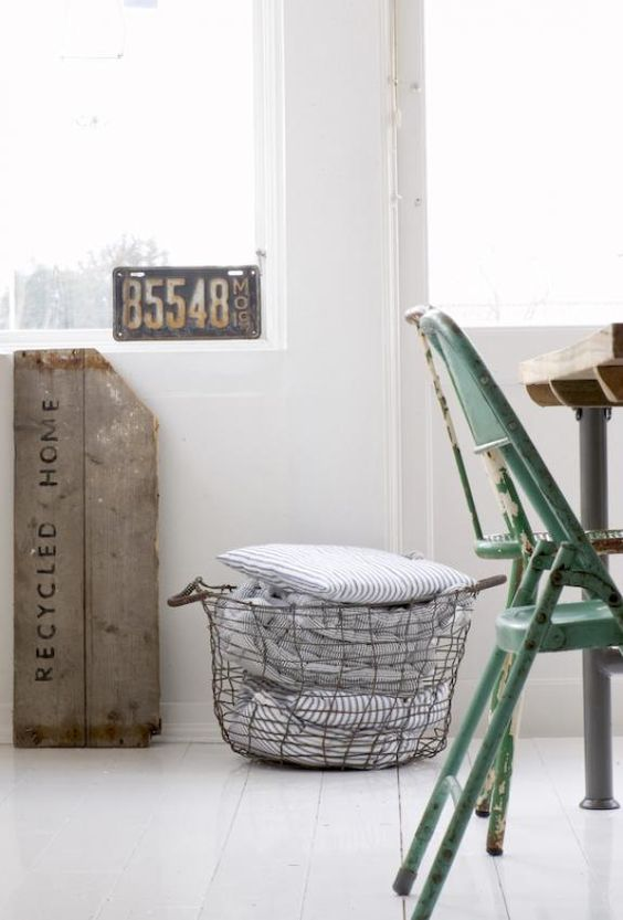 Wired bucket. Home details. Green folding chair.
